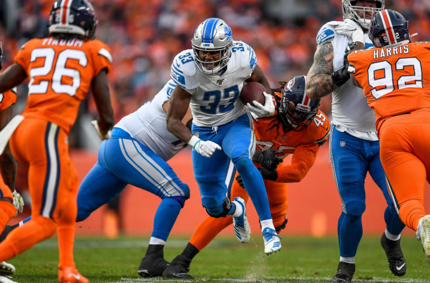 DENVER, CO - DECEMBER 22: Kerryon Johnson #33 of the Detroit Lions carries the ball in the third quarter of a game against the Denver Broncos at Empower Field on December 22, 2019 in Denver, Colorado. (Photo by Dustin Bradford/Getty Images)
