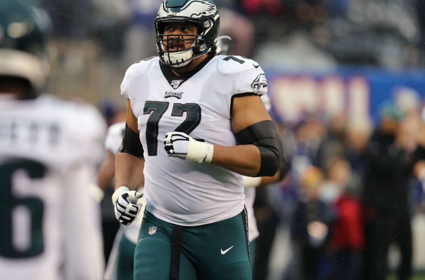 EAST RUTHERFORD, NEW JERSEY - DECEMBER 29: Tackle Halapoulivaati Vaitai #72 of the Philadelphia Eagles enters the field against the New York Giants in the rain in the first half at MetLife Stadium on December 29, 2019 in East Rutherford, New Jersey. (Photo by Al Pereira/Getty Images)