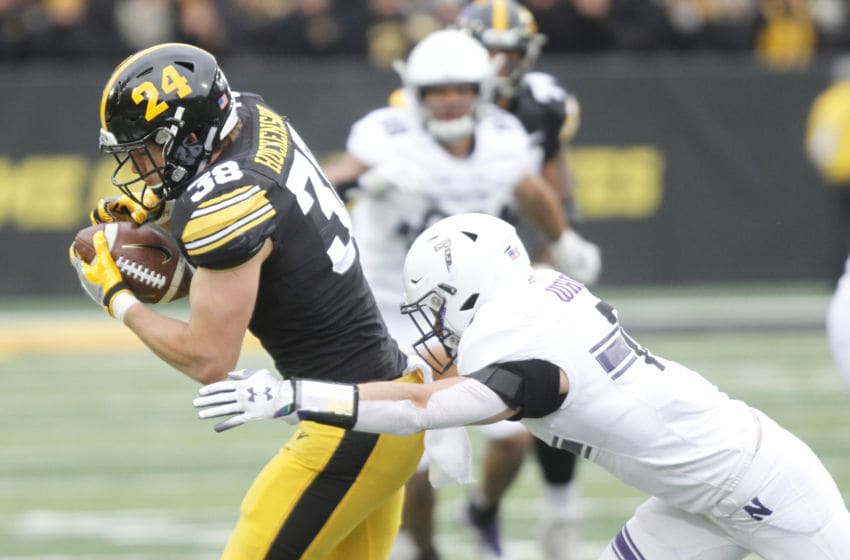 IOWA CITY, IOWA- NOVEMBER 10: Tight End T.J. Hockenson #38 of the Iowa Hawkeyes catches a pass during the first half in front of defensive back Travis Whillock #7 of the Northwestern Wildcats on November 10, 2018 at Kinnick Stadium, in Iowa City, Iowa. (Photo by Matthew Holst/Getty Images)