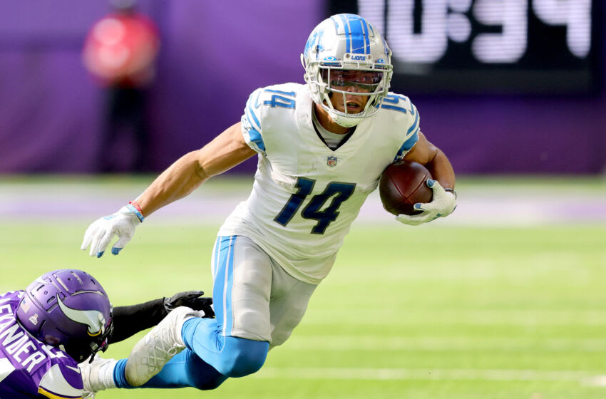 MINNEAPOLIS, MINNESOTA - OCTOBER 10: Amon-Ra St. Brown #14 of the Detroit Lions runs the ball during the second half against the Minnesota Vikings at U.S. Bank Stadium on October 10, 2021 in Minneapolis, Minnesota. (Photo by Adam Bettcher/Getty Images)