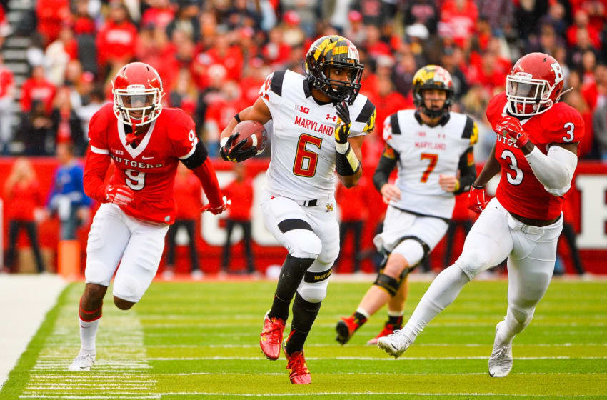 PISCATAWAY, NJ - NOVEMBER 28: Ty Johnson #6 of the Maryland Terrapins runs past Steve Longa #3 and Saquan Hampton #9 of the Rutgers Scarlet Knights before scoring a touchdown during a game at High Point Solutions Stadium on November 28, 2015 in Piscataway, New Jersey. (Photo by Alex Goodlett/Getty Images)