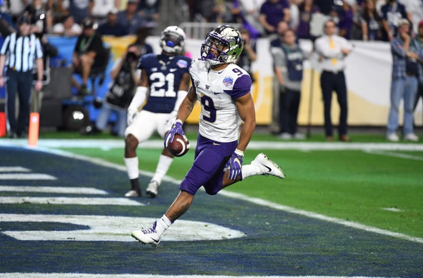 GLENDALE, AZ - DECEMBER 30: Myles Gaskin #9 of the Washington Huskies scores a 13 yard touchdown run against the Penn State Nittany Lions during the second quarter of the Playstation Fiesta Bowl at University of Phoenix Stadium on December 30, 2017 in Glendale, Arizona. (Photo by Norm Hall/Getty Images)