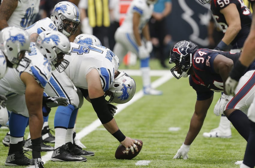 HOUSTON, TX - OCTOBER 30: Antonio Smith #94 of the Houston Texans lines up against Travis Swanson #64 of the Detroit Lions in the second quarter at NRG Stadium on October 30, 2016 in Houston, Texas. (Photo by Thomas B. Shea/Getty Images)