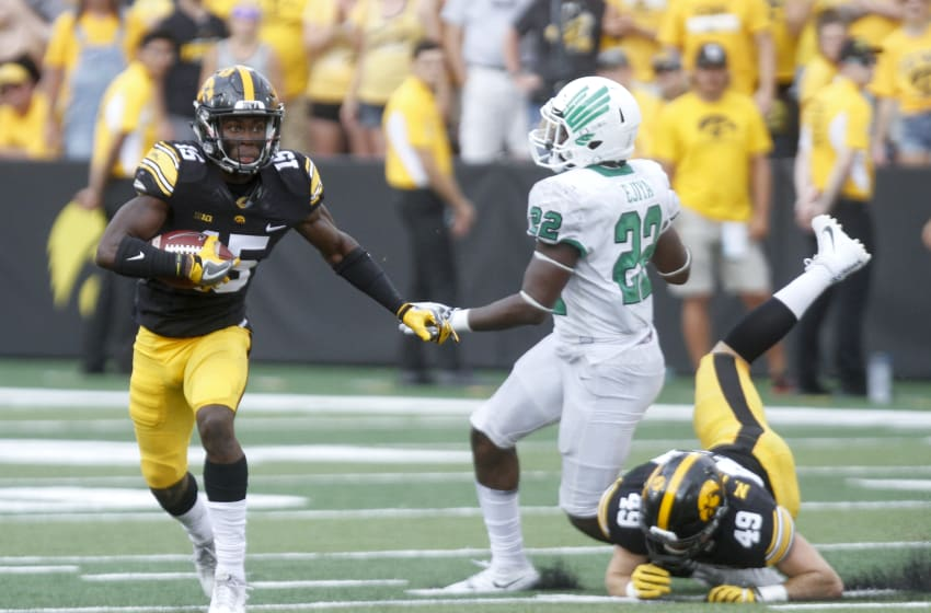 IOWA CITY, IOWA- SEPTEMBER 16: Defensive back Josh Jackson #15 of the Iowa Hawkeyes returns a kick during the fourth quarter in front of linebacker E.J. Ejiya #22 of the North Texas Mean Green on September 16, 2017 at Kinnick Stadium in Iowa City, Iowa. (Photo by Matthew Holst/Getty Images)
