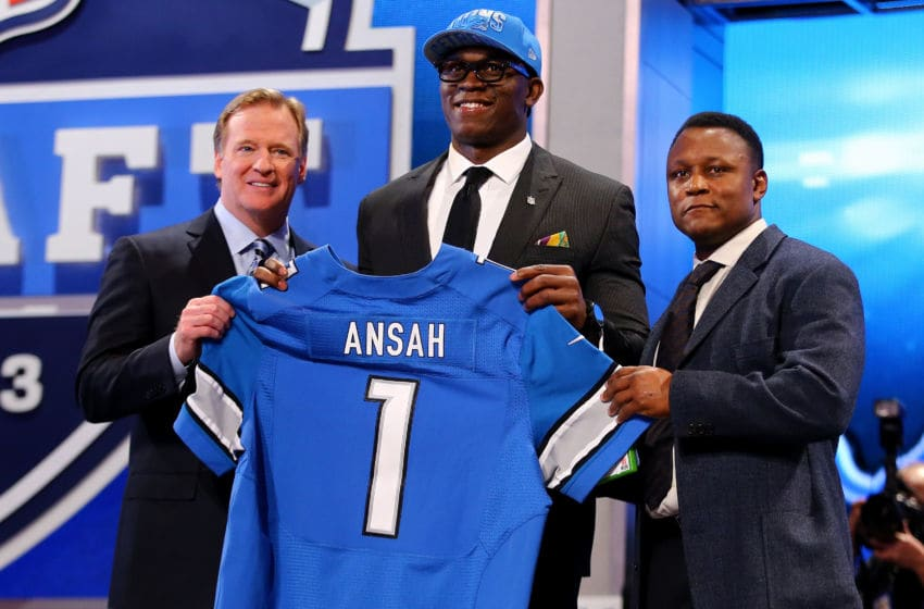 NEW YORK, NY - APRIL 25: Ezekiel Ansah of the BYU Cougars stands with NFL Commissioner Roger Goodell (L) and Pro Football Hall of Famer Barry Sanders (R) as they hold up a jersey on stage after Ansah was picked #5 overall by the Detroit Lions in the first round of the 2013 NFL Draft at Radio City Music Hall on April 25, 2013 in New York City. (Photo by Al Bello/Getty Images)