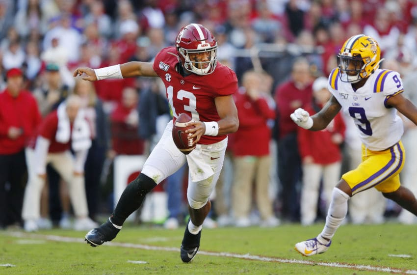 TUSCALOOSA, ALABAMA - NOVEMBER 09: Tua Tagovailoa #13 of the Alabama Crimson Tide attempts to escape pressure from Marcel Brooks #9 of the LSU Tigers during the first half in the game at Bryant-Denny Stadium on November 09, 2019 in Tuscaloosa, Alabama. (Photo by Kevin C. Cox/Getty Images)