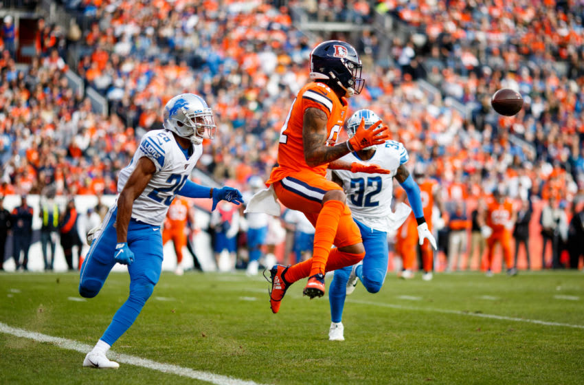 DENVER, CO - DECEMBER 22: Wide receiver Tim Patrick #81 of the Denver Broncos catches a pass near the goal line while being defended by cornerback Rashaan Melvin #29 and safety Tavon Wilson #32 of the Detroit Lions during the second quarter at Empower Field at Mile High on December 22, 2019 in Denver, Colorado. (Photo by Justin Edmonds/Getty Images)