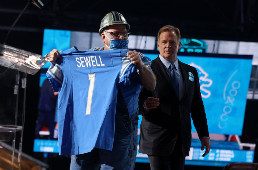 CLEVELAND, OHIO - APRIL 29: A Detroit Lions fan holds a jersey with NFL Commissioner Roger Goodell after the Lions selected Penei Sewell with the seventh pick during round one of the 2021 NFL Draft at the Great Lakes Science Center on April 29, 2021 in Cleveland, Ohio. (Photo by Gregory Shamus/Getty Images)