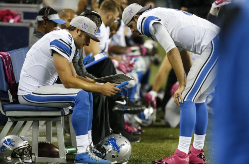 SEATTLE, WA - OCTOBER 5: Quarterback Matthew Stafford #9, left, of the Detroit Lions looks at a tablet device with quarterback Dan Orlovsky #8 of the Detroit Lions on the sidelines during a football game against the Seattle Seahawks at CenturyLink Field on October 5, 2015 in Seattle, Washington. The Seahawks won the game 13-10. (Photo by Stephen Brashear/Getty Images)