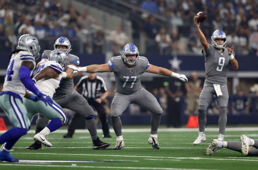 ARLINGTON, TX - SEPTEMBER 30: Frank Ragnow #77 of the Detroit Lions protects quarterback Matthew Stafford #9 as he passes against the Dallas Cowboys in the first quarter at AT&T Stadium on September 30, 2018 in Arlington, Texas. (Photo by Ronald Martinez/Getty Images)