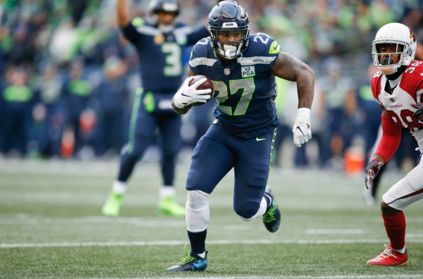 SEATTLE, WA - DECEMBER 30: Mike Davis #27 of the Seattle Seahawks runs the ball for a touchdown in the third quarter against the Arizona Cardinals at CenturyLink Field on December 30, 2018 in Seattle, Washington. (Photo by Otto Greule Jr/Getty Images)