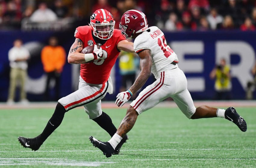 ATLANTA, GA - DECEMBER 01: Isaac Nauta #18 of the Georgia Bulldogs runs with the ball against Xavier McKinney #15 of the Alabama Crimson Tide in the first half during the 2018 SEC Championship Game at Mercedes-Benz Stadium on December 1, 2018 in Atlanta, Georgia. (Photo by Scott Cunningham/Getty Images)