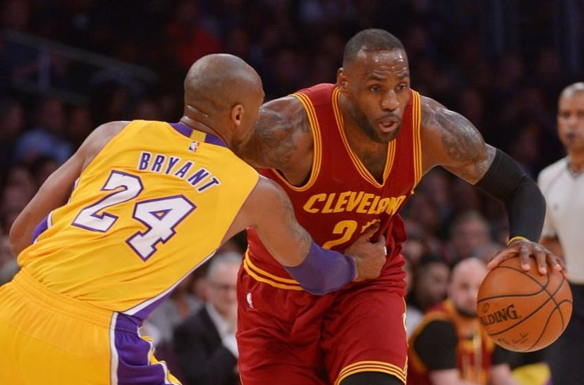 Mar 10, 2016; Los Angeles, CA, USA; Cleveland Cavaliers forward LeBron James (23) heads down court as Los Angeles Lakers forward Kobe Bryant (24) defends in the first quarter of the game at Staples Center. Mandatory Credit: Jayne Kamin-Oncea-USA TODAY Sports