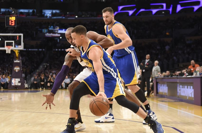 Mar 6, 2016; Los Angeles, CA, USA; Golden State Warriors guard Stephen Curry (30) drives to the basket against Los Angeles Lakers forward Kobe Bryant (24) during the NBA game at the Staples Center. Mandatory Credit: Richard Mackson-USA TODAY Sports