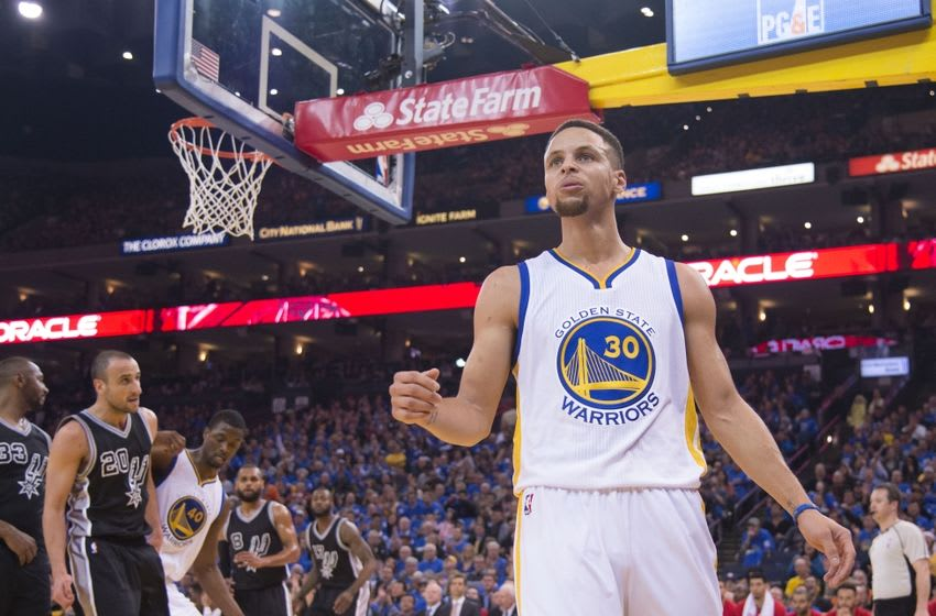 January 25, 2016; Oakland, CA, USA; Golden State Warriors guard Stephen Curry (30) celebrates after making a basket against the San Antonio Spurs during the first quarter at Oracle Arena. Mandatory Credit: Kyle Terada-USA TODAY Sports