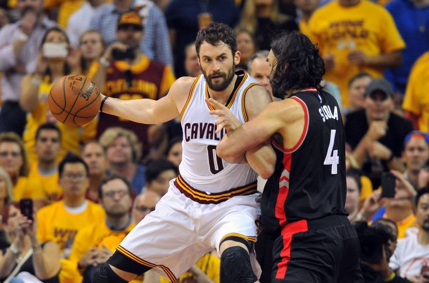 May 25, 2016; Cleveland, OH, USA; Cleveland Cavaliers forward Kevin Love (0) drives on Toronto Raptors forward Luis Scola (4) during the first quarter in game five of the Eastern conference finals of the NBA Playoffs at Quicken Loans Arena. Mandatory Credit: Ken Blaze-USA TODAY Sports