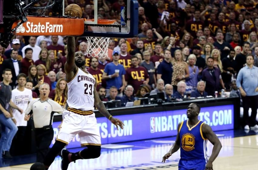 Jun 10, 2016; Cleveland, OH, USA; Cleveland Cavaliers forward LeBron James (23) shoots the ball against Golden State Warriors forward Draymond Green (23) in game four of the NBA Finals at Quicken Loans Arena. Mandatory Credit: Bob Donnan-USA TODAY Sports