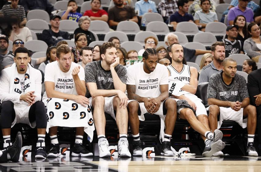 Oct 14, 2016; San Antonio, TX, USA; San Antonio Spurs players (left to right) Danny Green (14), along with David Lee (10) and Pau Gasol (16) and Kawhi Leonard (2) and Manu Ginobili (20) and Tony Parker (9) watch on the bench during the second half against the Miami Heat at AT&T Center. Mandatory Credit: Soobum Im-USA TODAY Sports