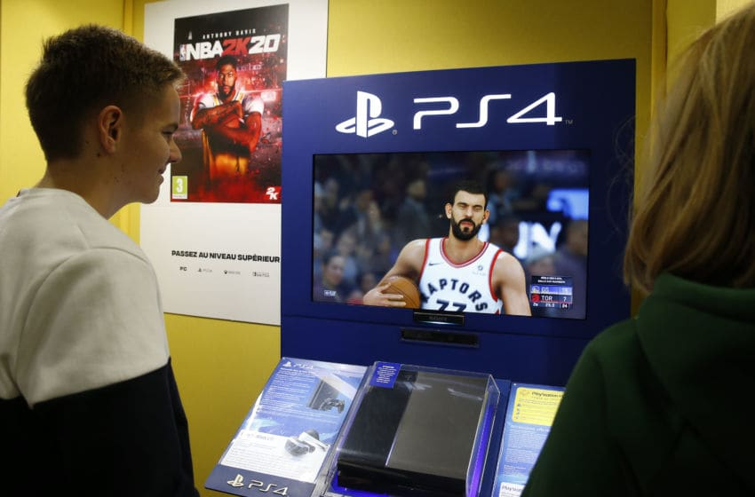 A gamer plays the video game 'NBA 2K12O' developed by Visual Concepts and published by 2K Sports on a Sony PlayStation game console PS4 Pro during the 'Paris Games Week' (Photo by Chesnot/Getty Images)
