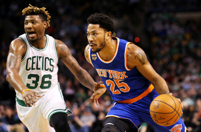 BOSTON, MA - JANUARY 18: Derrick Rose #25 of the New York Knicks drives against Marcus Smart #36 of the Boston Celtics during the first half at TD Garden on January 18, 2017 in Boston, Massachusetts. NOTE TO USER: User expressly acknowledges and agrees that, by downloading and or using this Photograph, user is consenting to the terms and conditions of the Getty Images License Agreement. (Photo by Maddie Meyer/Getty Images)