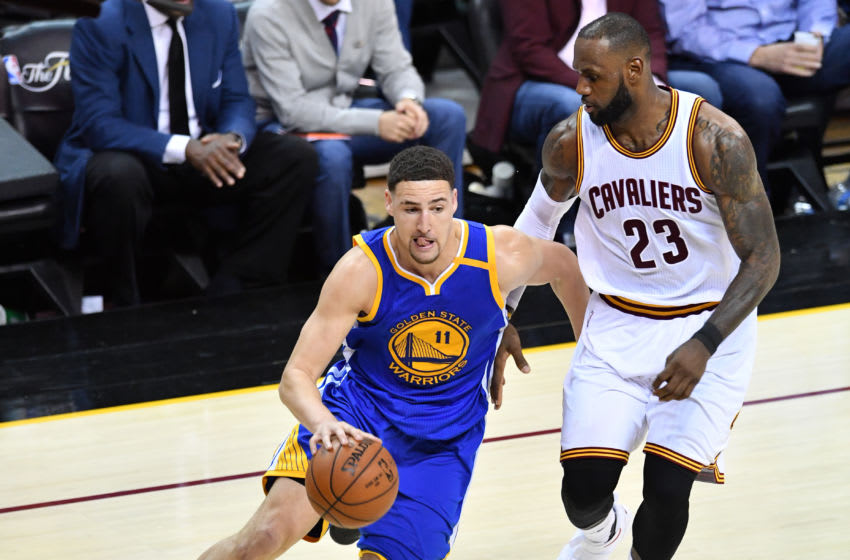CLEVELAND, OH - JUNE 07: Klay Thompson #11 of the Golden State Warriors is defended by LeBron James #23 of the Cleveland Cavaliers during the second half in Game 3 of the 2017 NBA Finals at Quicken Loans Arena on June 7, 2017 in Cleveland, Ohio. NOTE TO USER: User expressly acknowledges and agrees that, by downloading and or using this photograph, User is consenting to the terms and conditions of the Getty Images License Agreement. (Photo by Jason Miller/Getty Images)