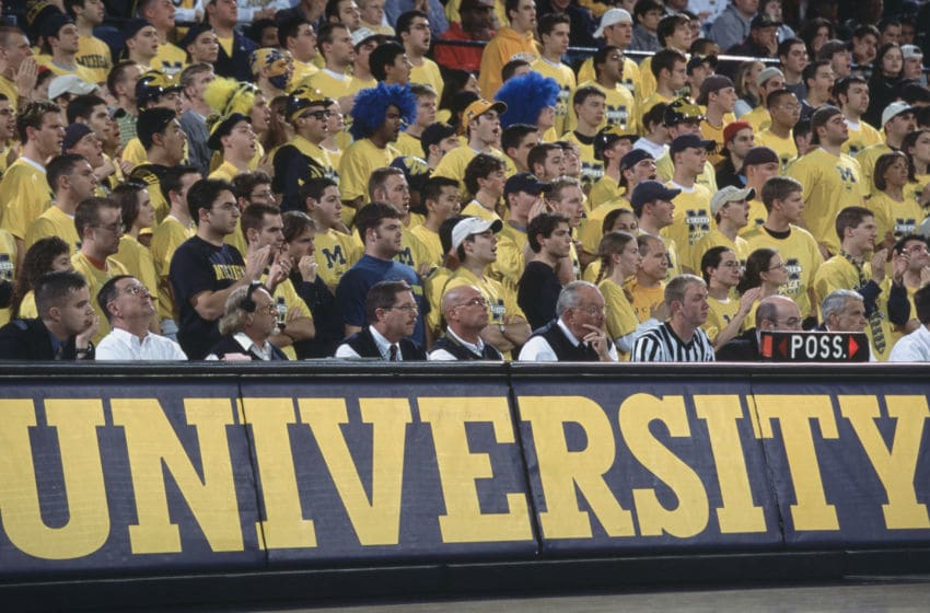 1 Dec 2001: Michigan Wolverines fans watch the NCAA basketball game against the Boston College Eagles at the Crisler Arena in Ann Arbor, Michigan. Boston College defeated Michigan 83-74. Mandatory Credit: Danny Moloshok/Allsport