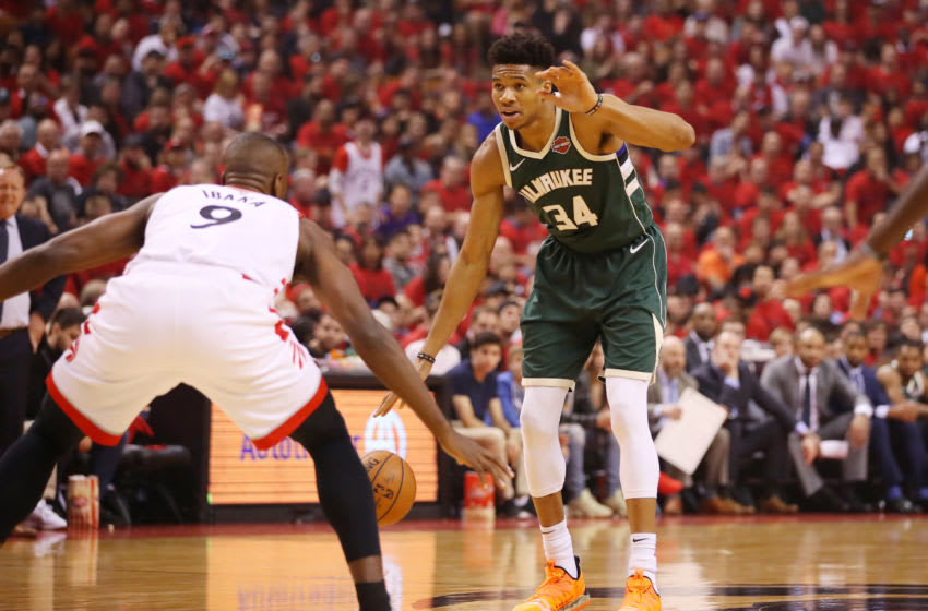 TORONTO, ONTARIO - MAY 19: Giannis Antetokounmpo #34 of the Milwaukee Bucks dribbles during the first half against the Toronto Raptors in game three of the NBA Eastern Conference Finals at Scotiabank Arena on May 19, 2019 in Toronto, Canada. NOTE TO USER: User expressly acknowledges and agrees that, by downloading and or using this photograph, User is consenting to the terms and conditions of the Getty Images License Agreement. (Photo by Gregory Shamus/Getty Images)