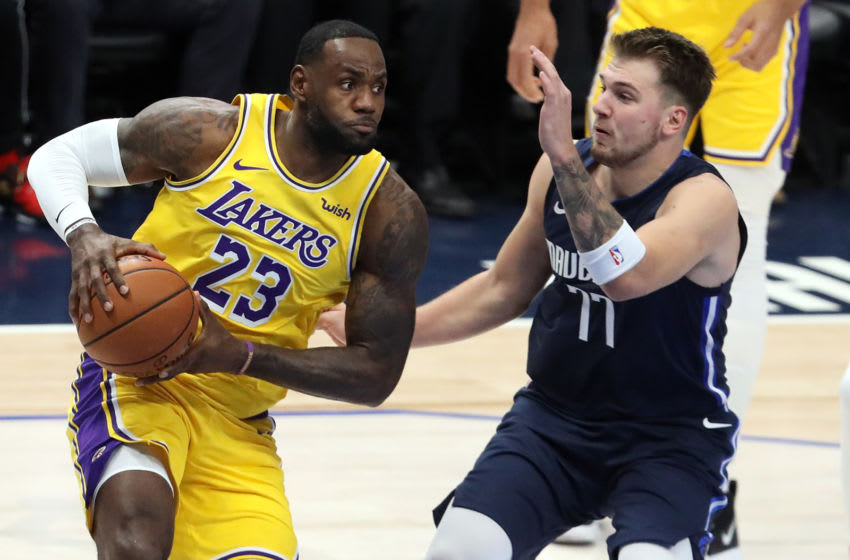 Lakers forward LeBron James and Mavs guard Luka Doncic (Photo by Ronald Martinez/Getty Images)
