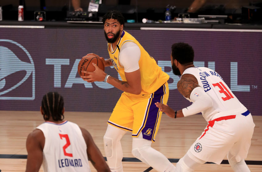 Lakers forward Anthony Davis holds the ball vs. the LA Clippers (Photo by Mike Ehrmann/Getty Images)