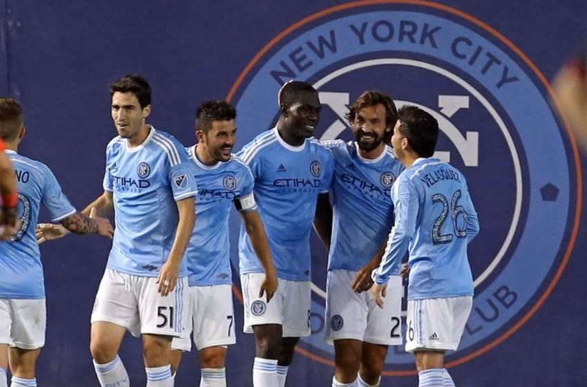 Aug 13, 2015; New York, NY, USA; New York City FC midfielder Kwadwo Poku (88) is congratulated by teammates after scoring a goal against the D.C. United during the second half of their soccer match at Yankee Stadium. NYCFC won 3-1. Mandatory Credit: Adam Hunger-USA TODAY Sports