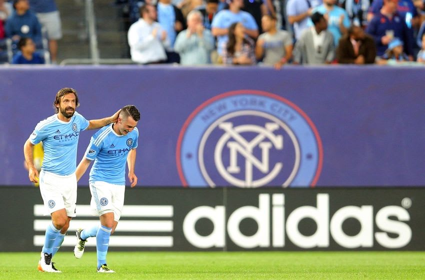 Jun 2, 2016; New York, NY, USA; New York City FC midfielder Jack Harrison (11) celebrates his goal against Real Salt Lake with New York City FC midfielder Andrea Pirlo (21) during a match at Yankee Stadium. Real Salt Lake defeated New York City 3-2. Mandatory Credit: Brad Penner-USA TODAY Sports