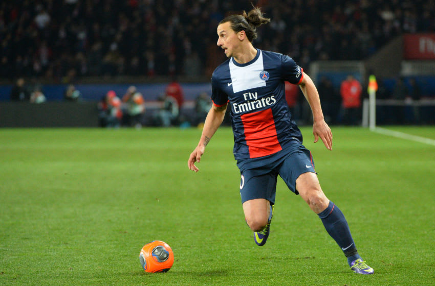 Paris Saint Germain's Zlatan Ibrahimoic challenges during their French League One soccer match, at the Parc des Princes stadium, in Paris, Sunday, March 2 , 2014.Photo. by ChristianLiewig (Photo by liewig christian/Corbis via Getty Images)