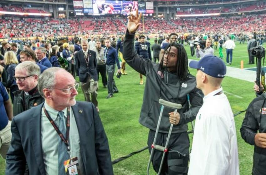 Jan 1, 2016; Glendale, AZ, USA; Notre Dame Fighting Irish linebacker Jaylon Smith (9) waves as he leaves the field following the 2016 Fiesta Bowl at University of Phoenix Stadium. Smith was injured in the first quarter and left the game. The Ohio State Buckeyes defeated Notre Dame 44-28. Mandatory Credit: Matt Cashore-USA TODAY Sports