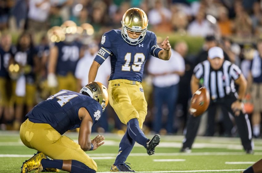 Sep 5, 2015; South Bend, IN, USA; Notre Dame Fighting Irish kicker Justin Yoon (19) kicks an extra point in the third quarter against the Texas Longhorns at Notre Dame Stadium. Notre Dame won 38-3. Mandatory Credit: Matt Cashore-USA TODAY Sports