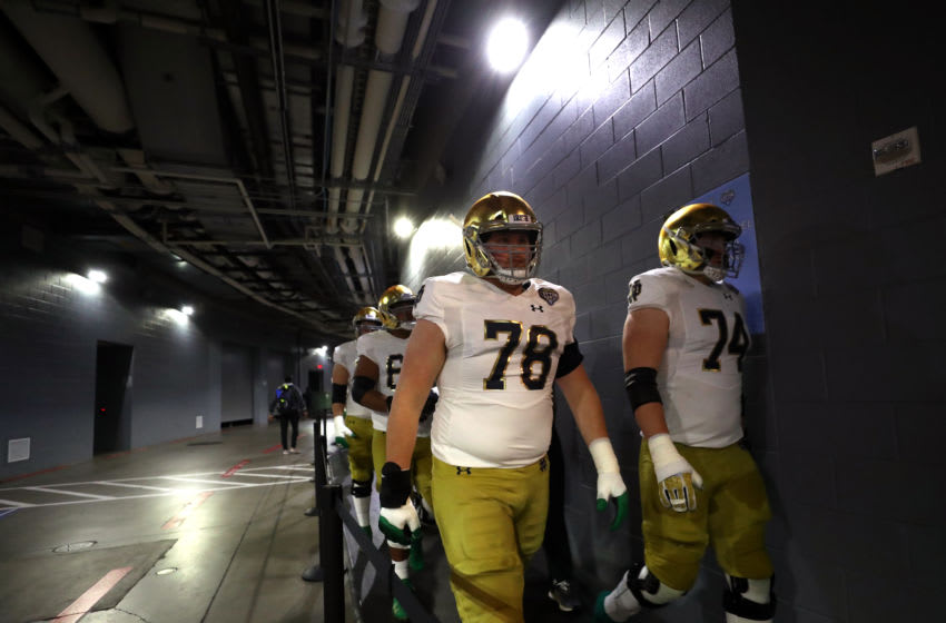 ARLINGTON, TEXAS - DECEMBER 29: Tommy Kraemer #78 of the Notre Dame Fighting Irish walks to the tunnel with teammates before the game against the Clemson Tigers during the College Football Playoff Semifinal Goodyear Cotton Bowl Classic at AT&T Stadium on December 29, 2018 in Arlington, Texas. (Photo by Ronald Martinez/Getty Images)