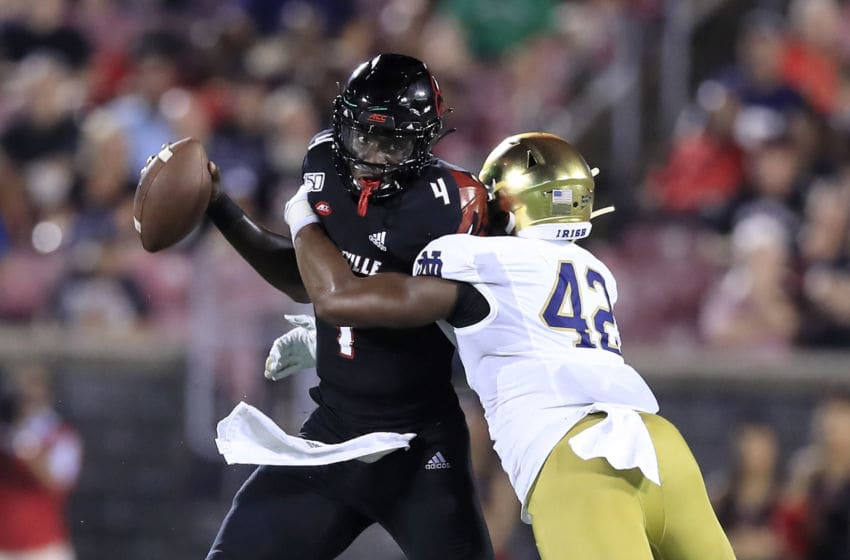 LOUISVILLE, KENTUCKY - SEPTEMBER 02: Jawon Pass #4 of the Louisville Cardinals attempts to throw the ball against while defended by Julian Okwara #42 of the Notre Dame Fighting Irish on September 02, 2019 in Louisville, Kentucky. (Photo by Andy Lyons/Getty Images)