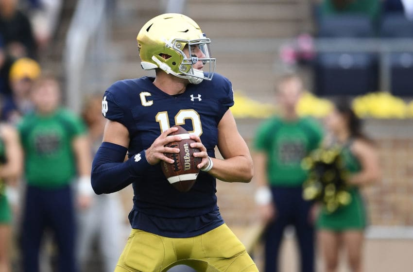 SOUTH BEND, INDIANA - SEPTEMBER 28: Ian Book #12 of the Notre Dame Fighting Irish drops back to pass during the first half against the Virginia Cavaliers at Notre Dame Stadium on September 28, 2019 in South Bend, Indiana. (Photo by Stacy Revere/Getty Images)