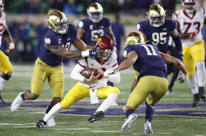 SOUTH BEND, IN - OCTOBER 12: Julian Okwara #42 and Alohi Gilman #11 of the Notre Dame Fighting Irish converge on Kedon Slovis #9 of the USC Trojans in the first half of the game at Notre Dame Stadium on October 12, 2019 in South Bend, Indiana. (Photo by Joe Robbins/Getty Images)