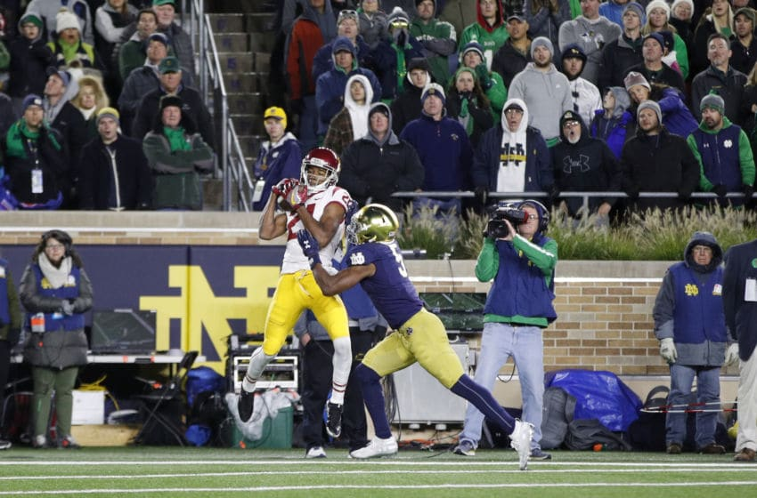SOUTH BEND, IN - OCTOBER 12: Tyler Vaughns #21 of the USC Trojans makes a five-yard touchdown reception behind Troy Pride Jr. #5 of the Notre Dame Fighting Irish in the second half of the game at Notre Dame Stadium on October 12, 2019 in South Bend, Indiana. Notre Dame defeated USC 30-27. (Photo by Joe Robbins/Getty Images)
