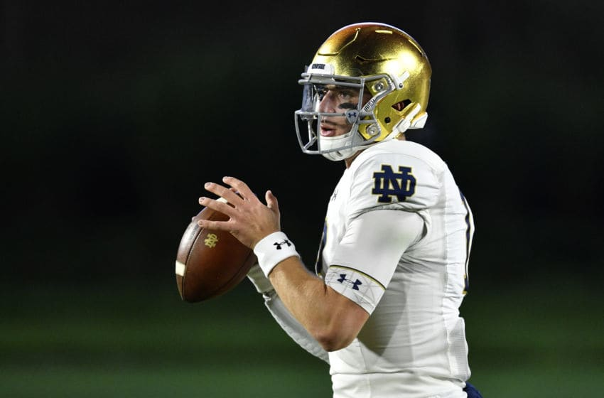 DURHAM, NORTH CAROLINA - NOVEMBER 09: Ian Book #12 of the Notre Dame Fighting Irish warms up before their game against the Duke Blue Devils at Wallace Wade Stadium on November 09, 2019 in Durham, North Carolina. (Photo by Grant Halverson/Getty Images)