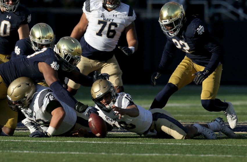 SOUTH BEND, INDIANA - NOVEMBER 16: Malcolm Perry #10 of the Navy Midshipmen fumbles the ball in the second quarter against the Wisconsin Badgers at Notre Dame Stadium on November 16, 2019 in South Bend, Indiana. (Photo by Dylan Buell/Getty Images)