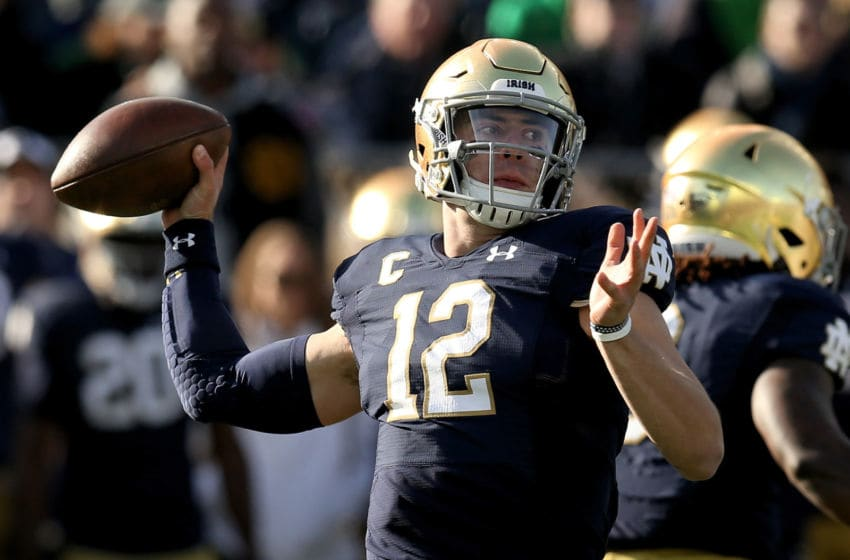 SOUTH BEND, INDIANA - NOVEMBER 16: Ian Book #12 of the Notre Dame Fighting Irish throws a pass in the first quarter against the Navy Midshipmen at Notre Dame Stadium on November 16, 2019 in South Bend, Indiana. (Photo by Dylan Buell/Getty Images)