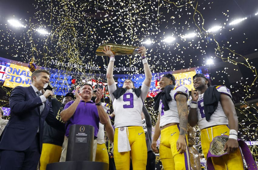 NEW ORLEANS, LOUISIANA - JANUARY 13: Head coach Ed Orgeron of the LSU Tigers, Joe Burrow #9 of the LSU Tigers and Grant Delpit #7 of the LSU Tigers celebrate with the trophy after defeating the Clemson Tigers 42-25 in the College Football Playoff National Championship game at Mercedes Benz Superdome on January 13, 2020 in New Orleans, Louisiana. (Photo by Kevin C. Cox/Getty Images)
