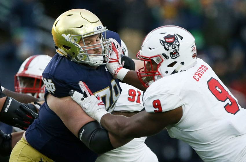 SOUTH BEND, IN - OCTOBER 28: Tommy Kraemer #78 of the Notre Dame Fighting Irish blocks against Bradley Chubb #9 of the North Carolina State Wolfpack in the second quarter at Notre Dame Stadium on October 28, 2017 in South Bend, Indiana. (Photo by Dylan Buell/Getty Images)
