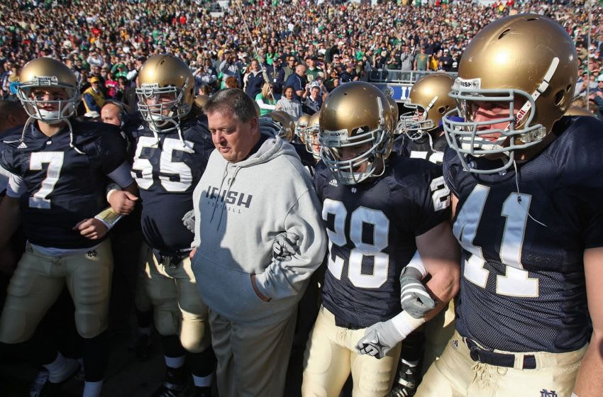 SOUTH BEND, IN - NOVEMBER 21: Head coach Charlie Weis of the Notre Dame Fighting Irish waits to enter the field with (L-R) Jimmy Clausen #7, Eric Olsen #55, Kyle McCarthy #28 and Scott Smith #41 before a game against the University of Connecticut Huskies at Notre Dame Stadium on November 21, 2009 in South Bend, Indiana. (Photo by Jonathan Daniel/Getty Images)