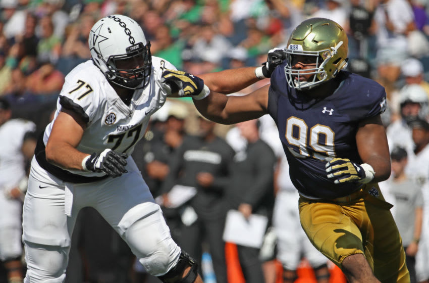 SOUTH BEND, IN - SEPTEMBER 15: Jerry Tillery #99 of the Notre Dame Fighting Irish rushes against Devin Cochran #77 of the Vanderbilt Commodores at Notre Dame Stadium on September 15, 2018 in South Bend, Indiana. (Photo by Jonathan Daniel/Getty Images)