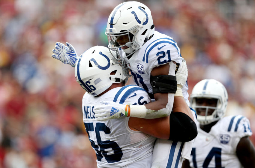 LANDOVER, MD - SEPTEMBER 16: Nyheim Hines #21 of the Indianapolis Colts celebrates scoring a first half touchdown with teammate Quenton Nelson #56 against the Washington Redskins for a first half touchdown at FedExField on September 16, 2018 in Landover, Maryland. (Photo by Rob Carr/Getty Images)