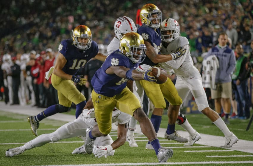 SOUTH BEND, IN - SEPTEMBER 29: Miles Boykin #81 of the Notre Dame Fighting Irish stretches for the touchdown as Malik Antoine #3 of the Stanford Cardinal tries to make the stop at Notre Dame Stadium on September 29, 2018 in South Bend, Indiana. (Photo by Michael Hickey/Getty Images)