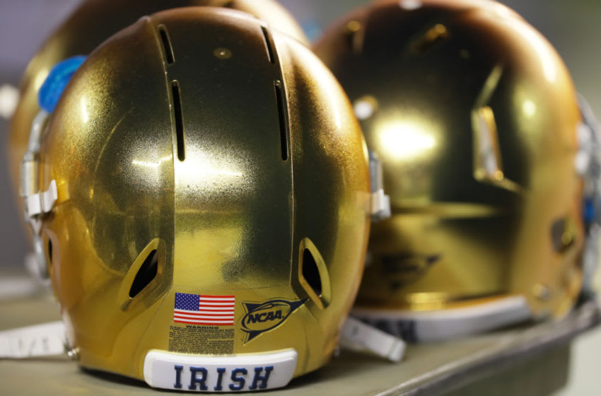 SAN DIEGO, CA - OCTOBER 27: Helmets of the Notre Dame Fighting Irish near the bench area in the 2nd half against the Navy Midshipmen at SDCCU Stadium on October 27, 2018 in San Diego, California. (Photo by Kent Horner/Getty Images)