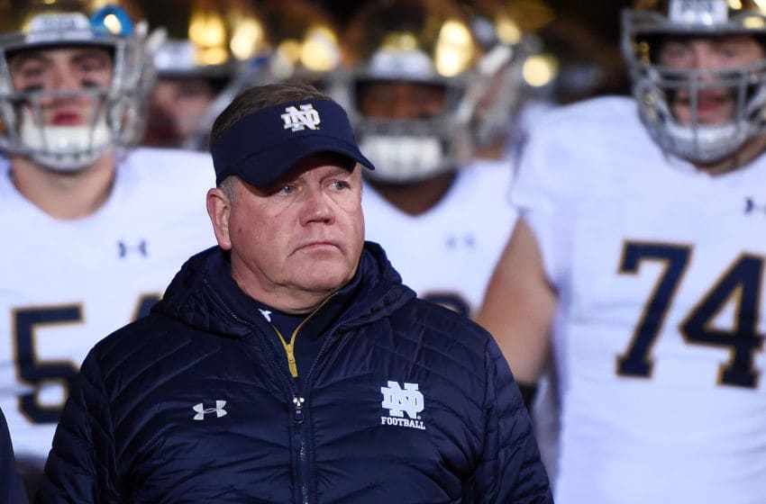 EVANSTON, IL - NOVEMBER 03: Head coach Brian Kelly of the Notre Dame Fighting Irish leads his team onto the field prior to a game against the Northwestern Wildcats at Ryan Field on November 3, 2018 in Evanston, Illinois. (Photo by Stacy Revere/Getty Images)